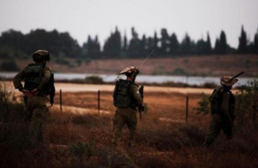 IDF soldiers patrol near Gaza 370 (photo credit: Reuters/Amir Cohen)