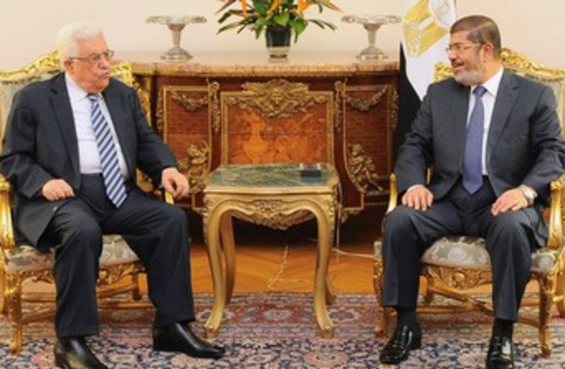 Mahmoud Abbas with Mohamed Morsi in Cairo 370 (R) (photo credit: Reuters / handout)