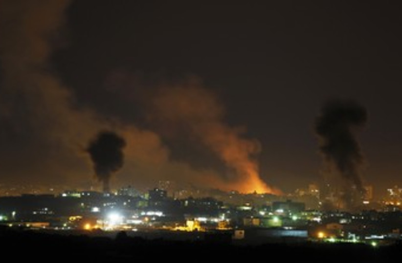 IAF strikes in Gaza 370 (photo credit: REUTERS/Darren Whiteside)