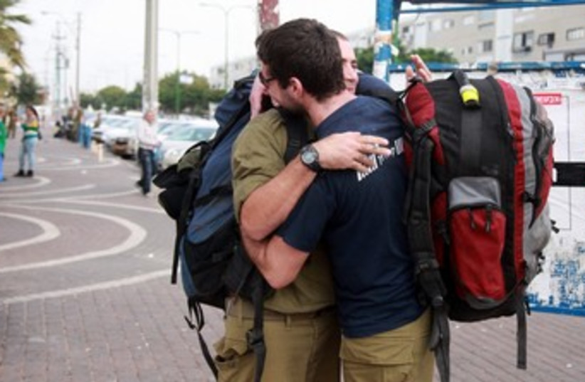 Reserve soldiers prepare to deploy in Ashkelon 370 (photo credit: marc israel sellem / the jerusalem post)