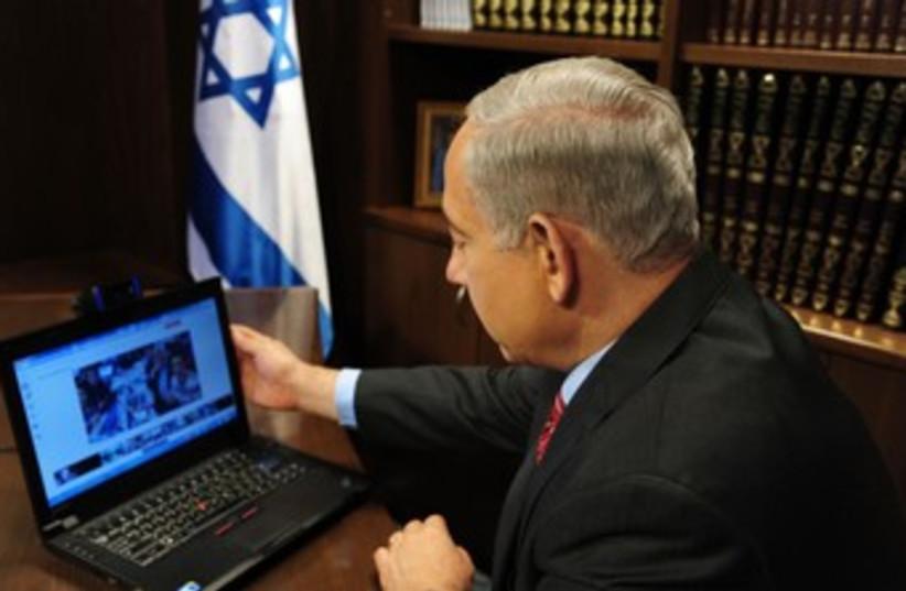 Netanyahu and laptop 370 (photo credit: Courtesy)