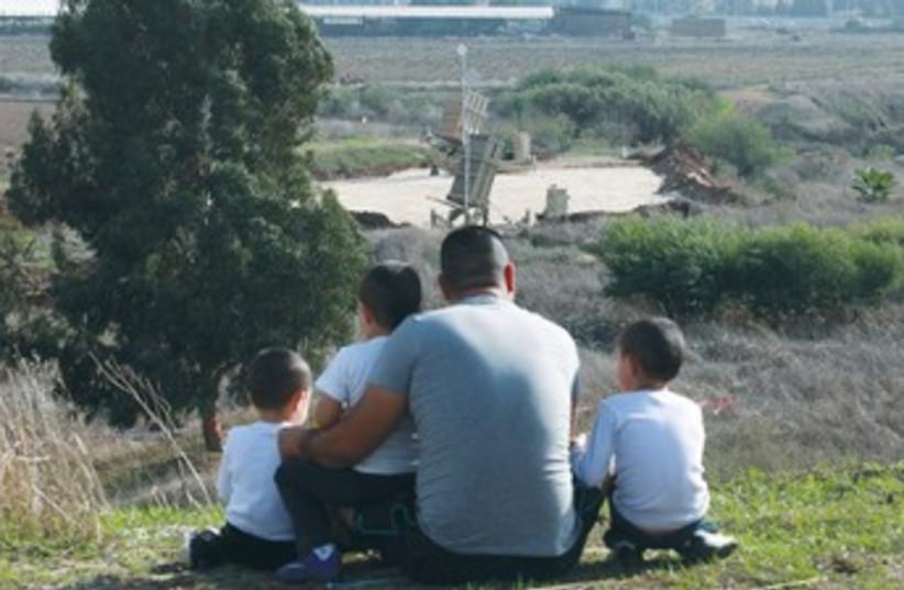 Onlookers at Gush Dan Iron Dome battery 370 (photo credit: Marc Israel Sellem/The Jerusalem Post)