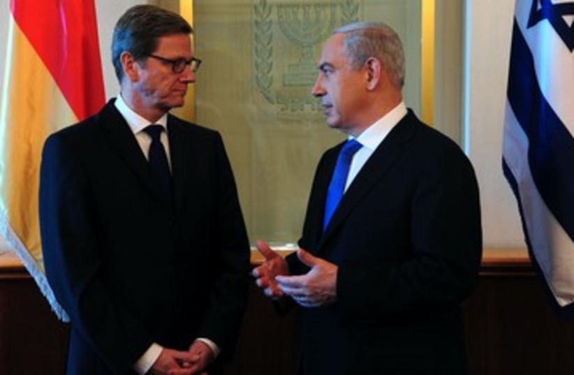 German FM Guido Westerwelle with PM Netanyahu 390 (photo credit: Koby Gidon/GPO)