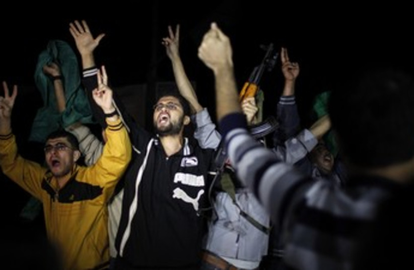Gazans celebrate after cease-fire 370 (photo credit: Reuters)