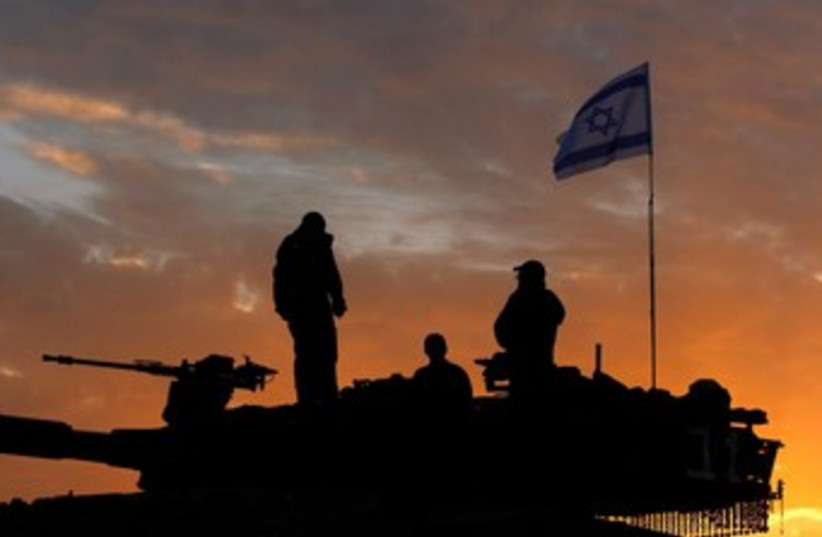 Reserve soldiers at sunset 370 (photo credit: REUTERS)