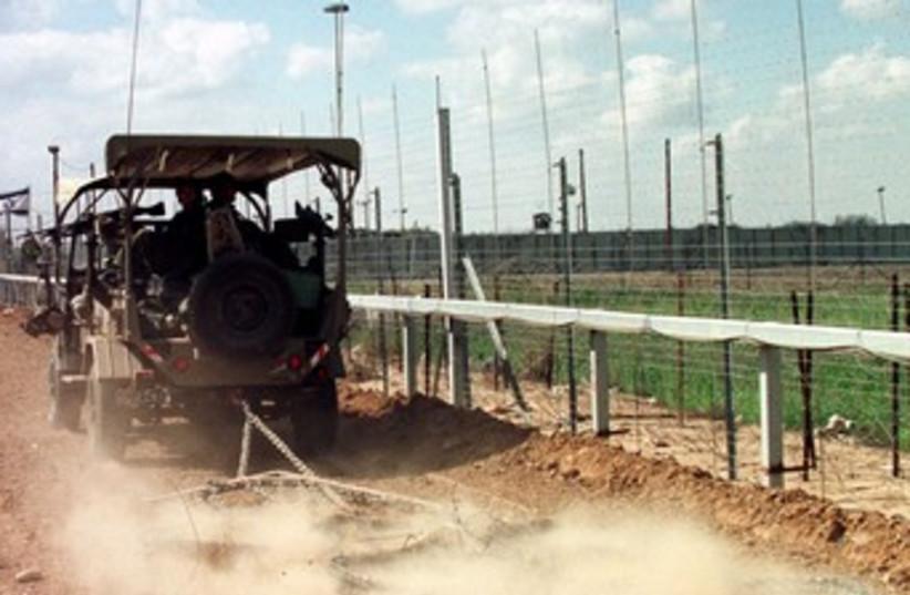 IDF vehicle along Gaza border fence 370 (photo credit: REUTERS)
