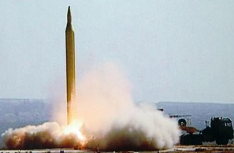 Iran test fires a Fajr-3 missile 370 (R) (photo credit: IRNA / Reuters)