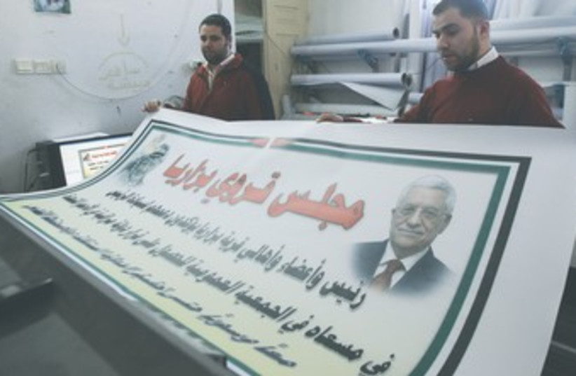 Nablus men hold poster of Abbas and Arafat 370 (photo credit: Abed Omar Qusini/ Reuters)
