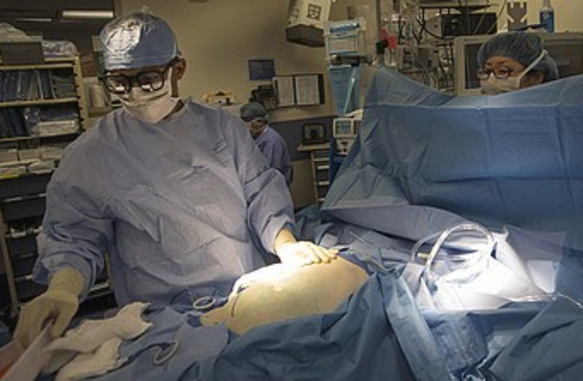 Organ transplant surgery doctor medical dr. 370 (R) (photo credit: Keith Bedford / Reuters)