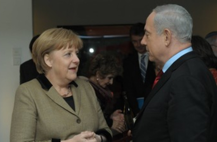 Prime Minister Netanyahu and German Chancellor Merkel 370 (photo credit: GPO / Amos Ben-Gershom)