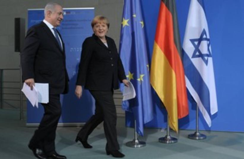 Merkel and PM 370 (photo credit: GPO)