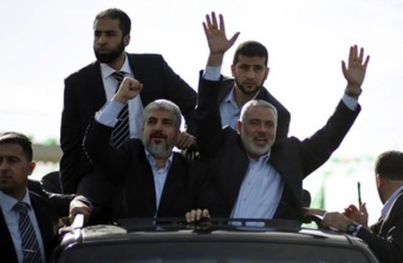 Hamas leader Khaled Mashaal arrives in Gaza 370 (R) (photo credit: Mohammed Salem / Reuters)
