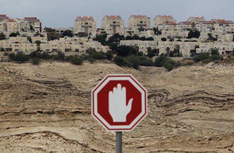 e1 stop 521 (photo credit: Ammar Awad/Reuters)