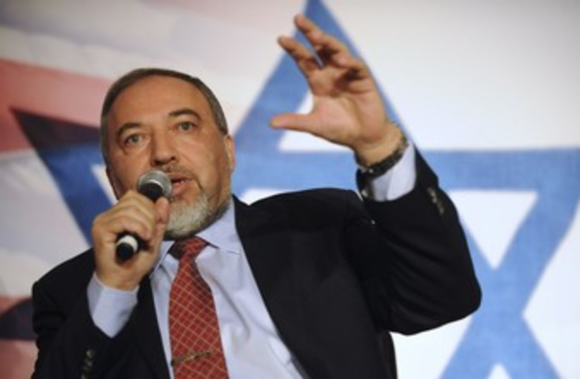 Liberman in front of star of david 370 (photo credit: REUTERS/Mary Calvert)