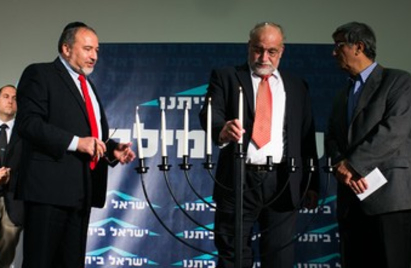 Liberman lights candles with Rotem and Ohayon 370 (photo credit: Courtesy)