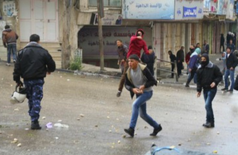 Palestinian stone throwers in Hebron after funeral 150 (photo credit: TOVAH LAZAROFF)