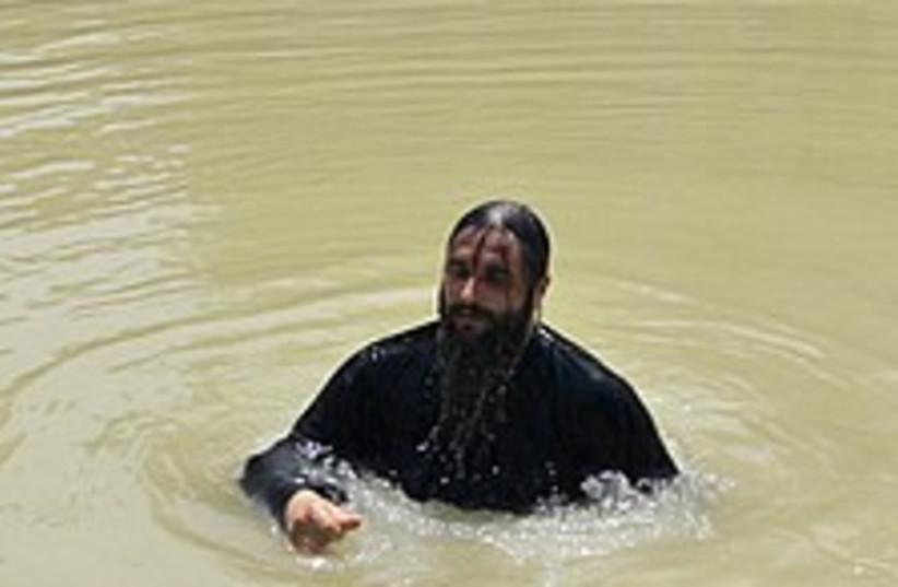 Jordan river immersing 2 (photo credit: AP)