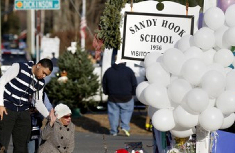 Memorial Sandy Hook Elementary School 150 (photo credit: REUTERS/Shannon Stapleton)