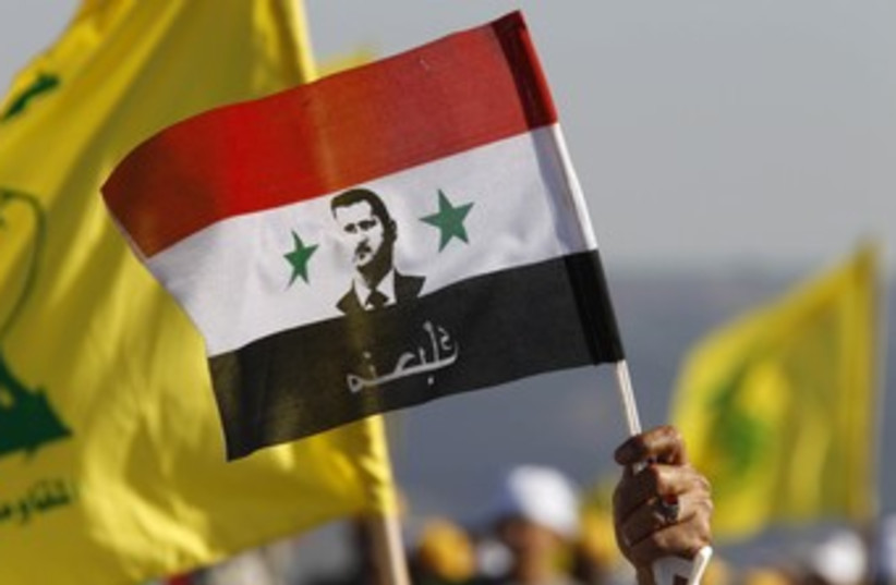 Flags of Hezbollah, Assad's Syria 370 (photo credit: REUTERS/Ali Hashisho)