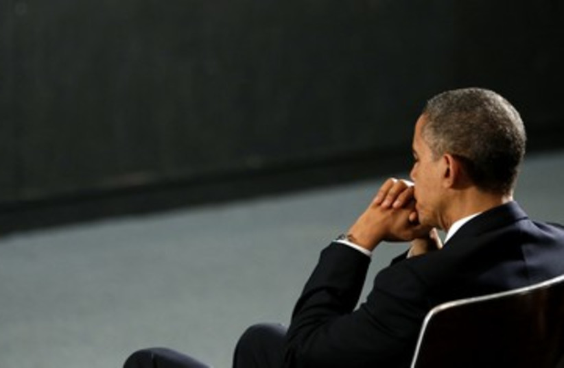 US President Barack Obama, pensive at CT vigil 390 (photo credit: Kevin Lamarque / Reuters)