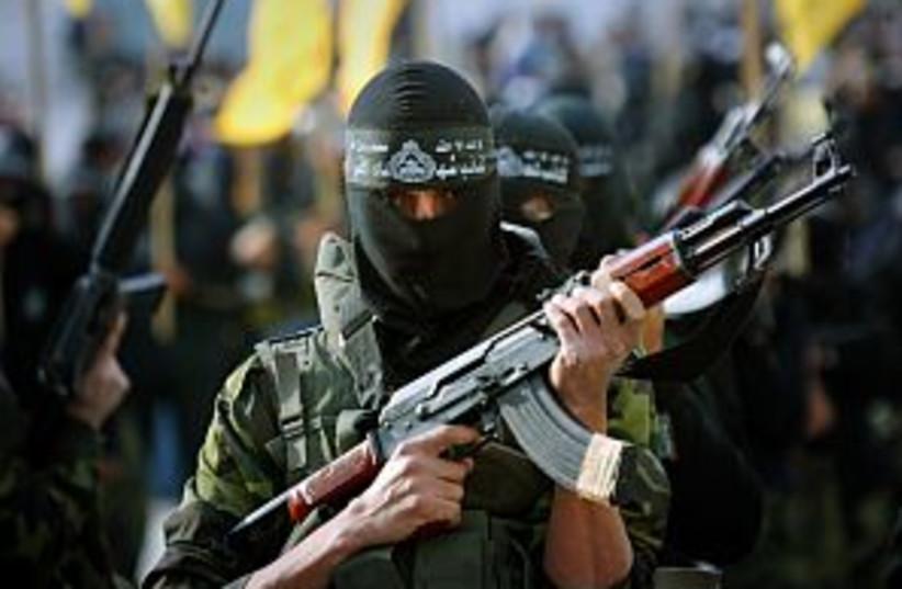 al aksa man gun 298.88 (photo credit: AP [file])