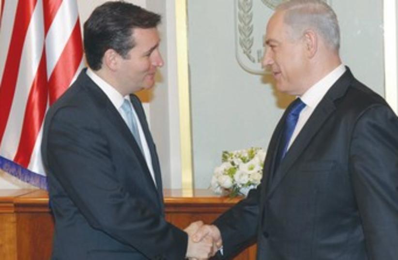 PM shakes hands with Republican senator-elect Ted Cruz 370 (photo credit: Amos Ben-Gershom/GPO)