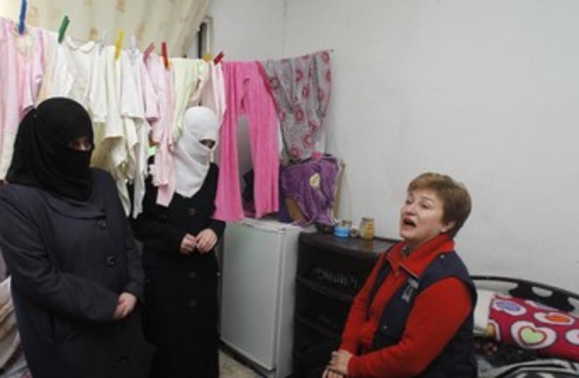 EU Commissioner  visits Syria refugees in Amman 370 (photo credit: REUTERS)