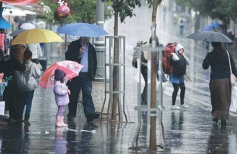 Pedestrians in rain 370 (photo credit: Marc Israel Sellem/The Jerusalem Post)