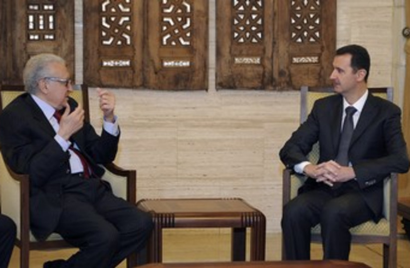 Brahimi and Assad 370 (photo credit: REUTERS/Sana Sana)