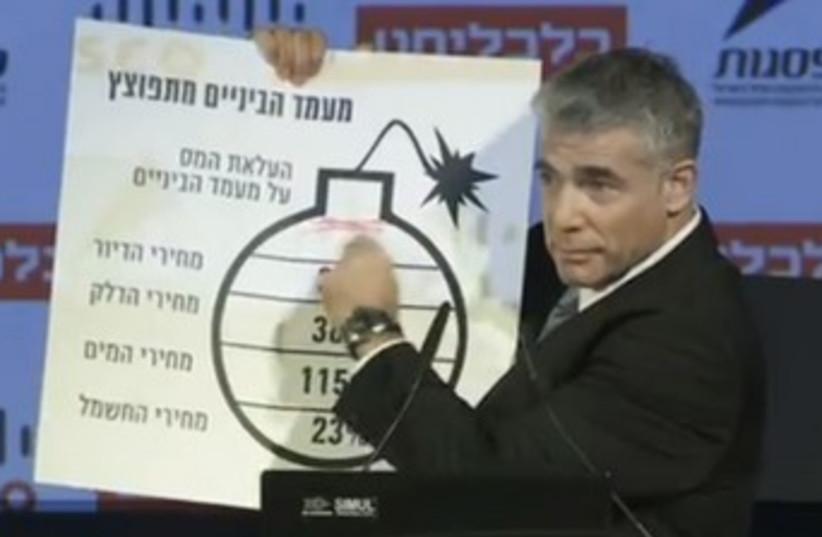 Yair Lapid with bomb cartoon 370 (photo credit: Screenshot)