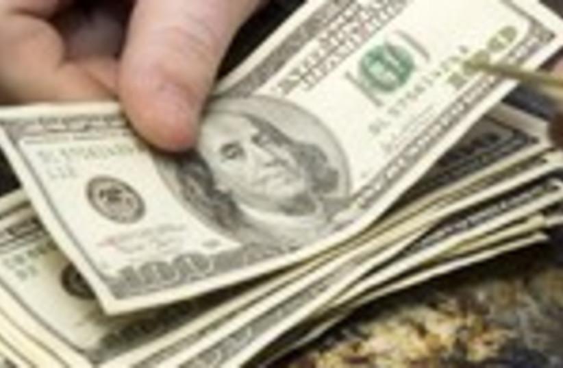 Dollar bills 150 (photo credit: Steve Marcus / Reuters)