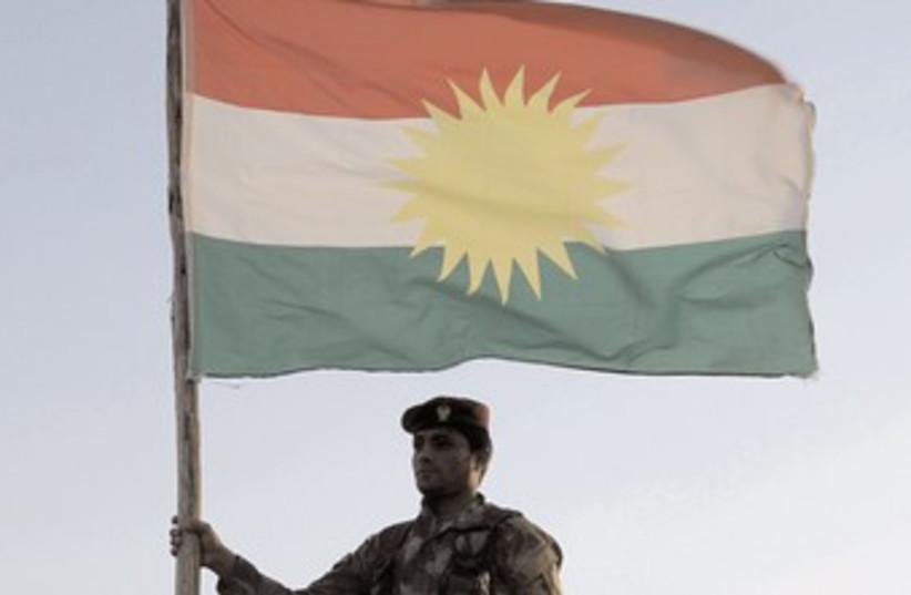 Kurdish soldier flag 370 (photo credit: Azad Lashkari/Reuters)