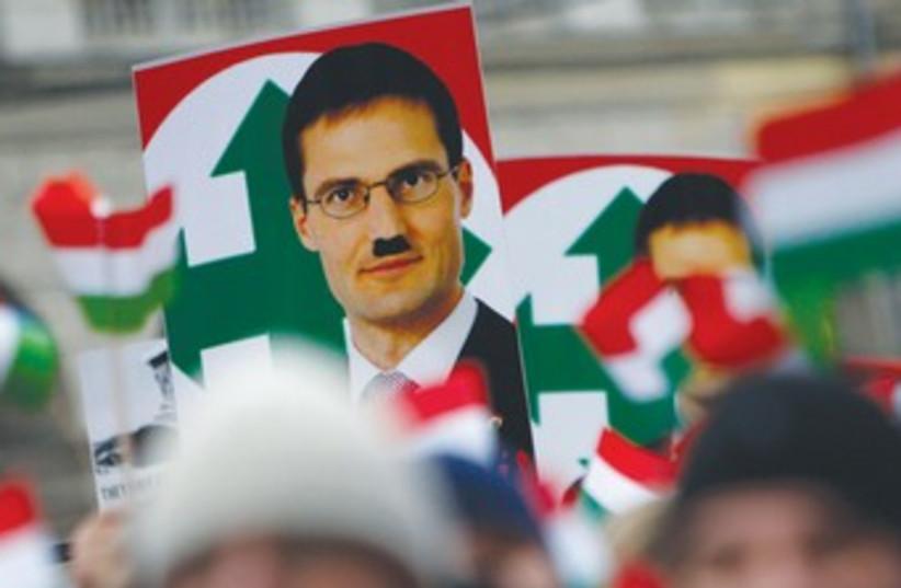 Defaced placard of Jobbik Party leader Gyongyosi 370 (photo credit: REUTERS)