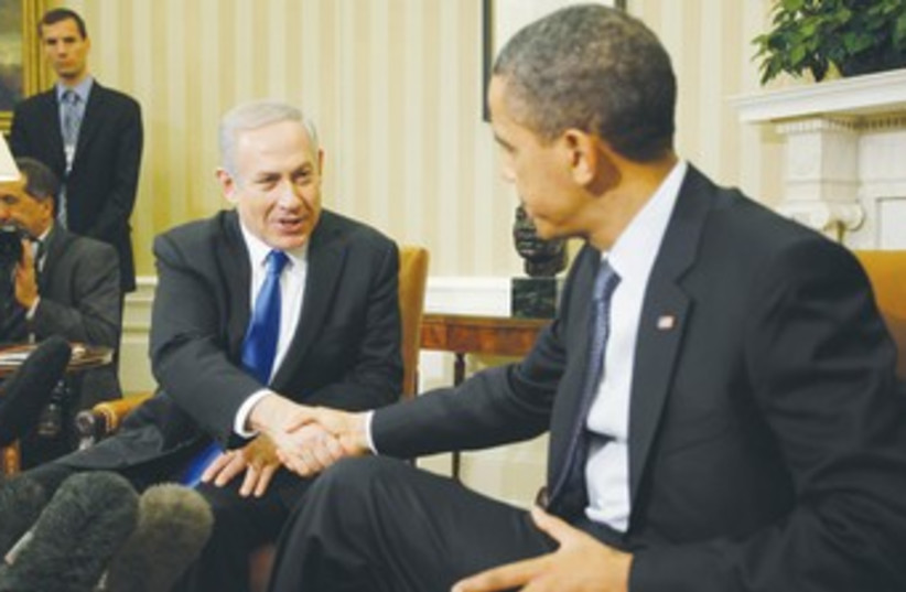 Netanyahu and Obama shake hands 370 (photo credit: REUTERS)