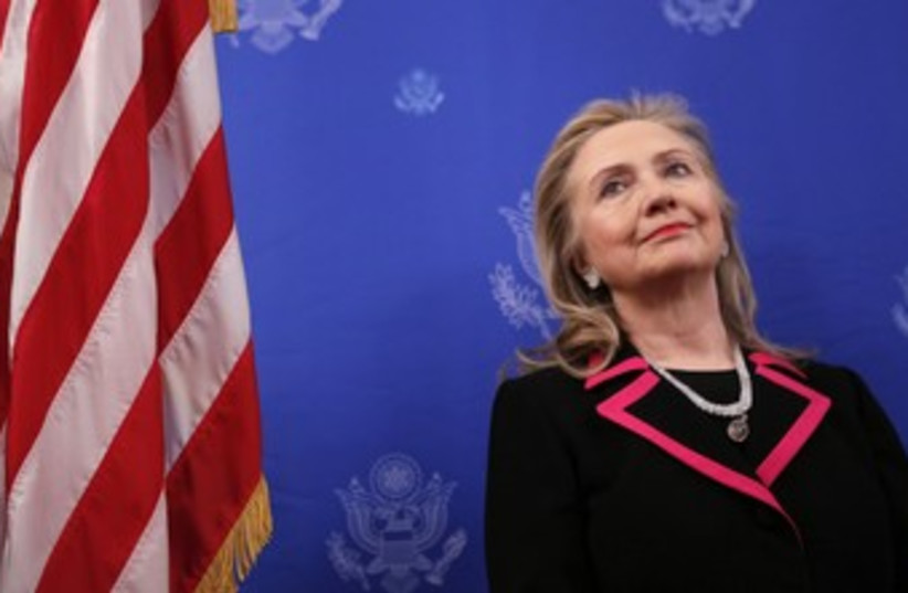US Secretary of State Hillary Clinton 370 (R) (photo credit: Kevin Lamarque / Reuters)