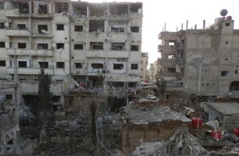 Damaged buildings in Daraya near Damascus 370 (photo credit: reuters)