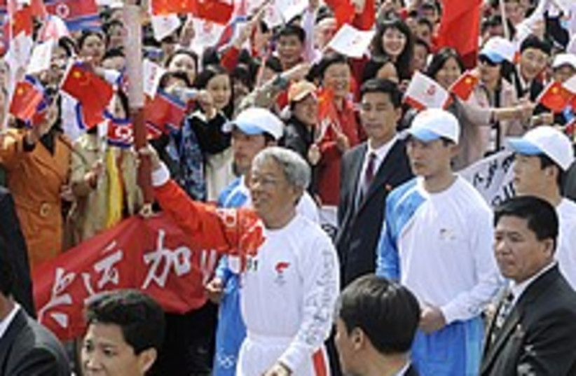 N. Korea torch 224.88 (photo credit: AP)
