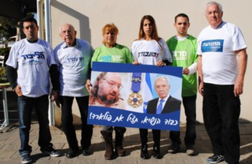 Various party representatives campaign for Pollard  370 (photo credit: Adi Ginsburg)