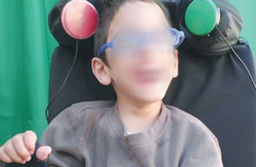Disabled child in special wheelchair 370 (photo credit: Courtesy Chimes)