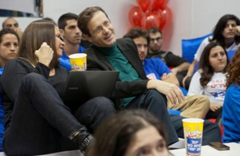 Shelly Yachimovich and Isaac Herzog watch election ads 370 (photo credit: Shai Skiff)