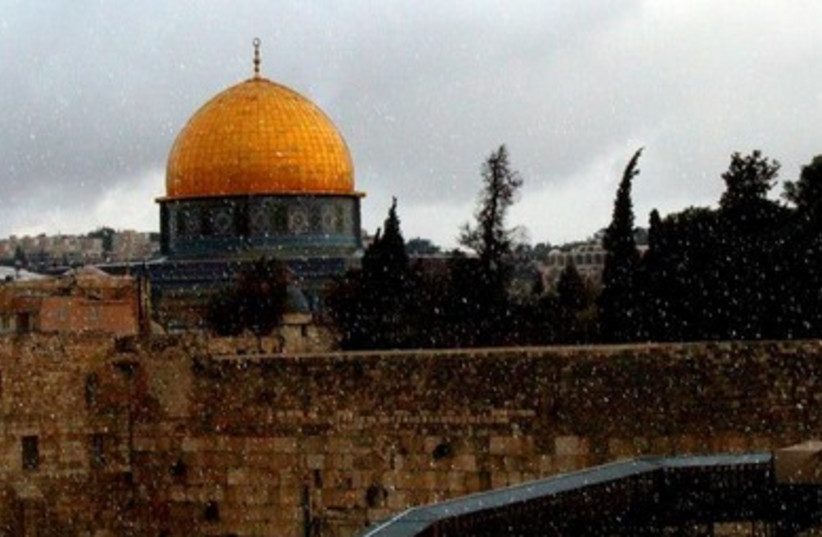 Snow falls in Jerusalem at Western Wall