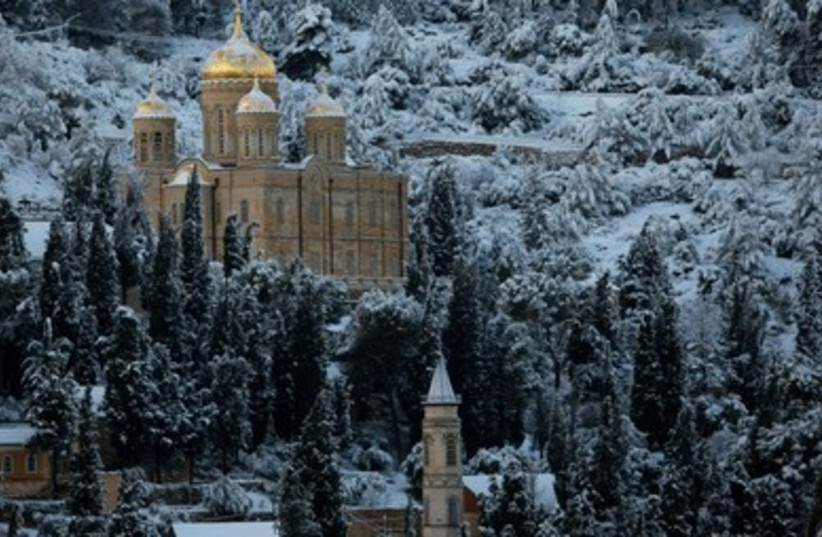 Snow covers the Russian Church 390 (photo credit: Reuters/Ronen Zvulun)