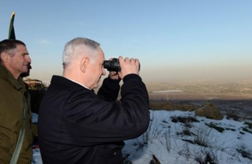 Netanyahu surveys Syrian border 370 (photo credit: Koby Gideon/GPO)