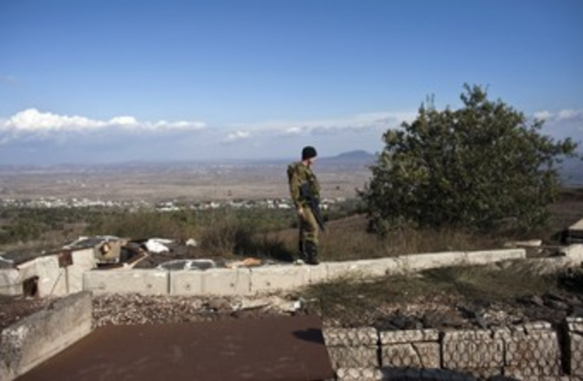 IDF soldier in the Golan overlooking Syria 370 (R) (photo credit: NIR ELIAS / Reuters)