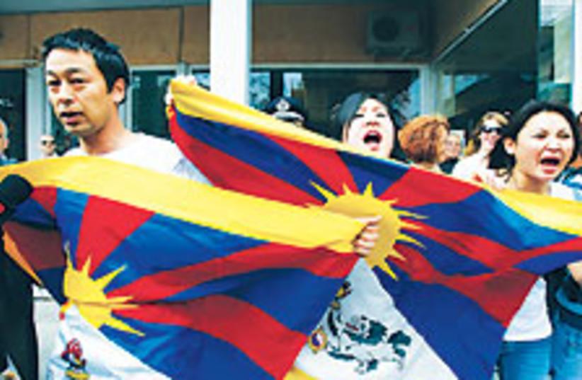 Tibet activists 88 224 (photo credit: AP [file])