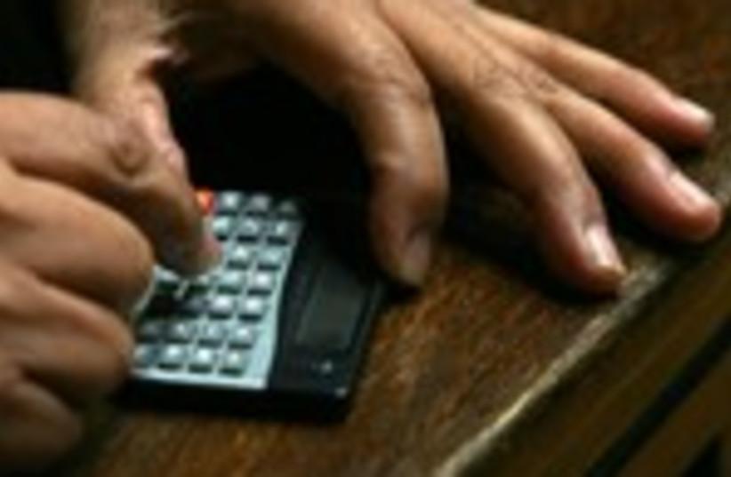 An accountant calculator taxes 150 (photo credit: Ivan Alvarado / Reuters)