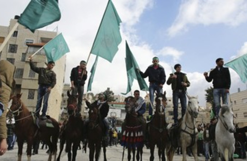 Hamas supporters rally in Hebron 370 (photo credit: REUTERS)