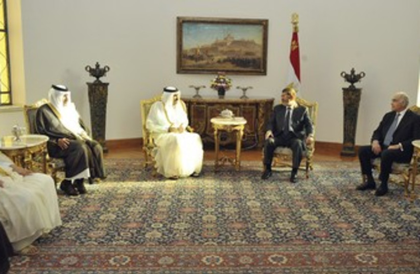 Egypt's Morsi meets with Qatari PM 370 (photo credit: REUTERS)