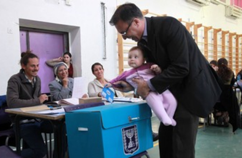 Father and daughter vote 370 (photo credit: Marc Israel Sellem/The Jerusalem Post)