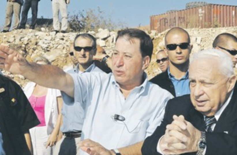 Ron Nachman and Ariel Sharon 370 (photo credit: Reuters)